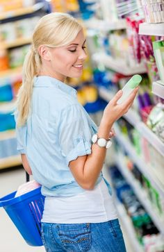 woman choosing cosmetics Is it Worth Spending More on Organic Cosmetics & Toiletries?