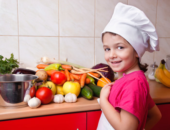 girl cooking Cheap and Cheerful Meat Free Meals