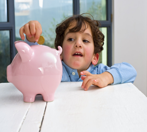 boy with money box Why Teach Children to Save Up Their Pocket Money