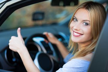 womanincar Three Ways to Save Money on the Road