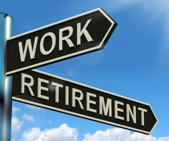 Work and Retire on a road sign